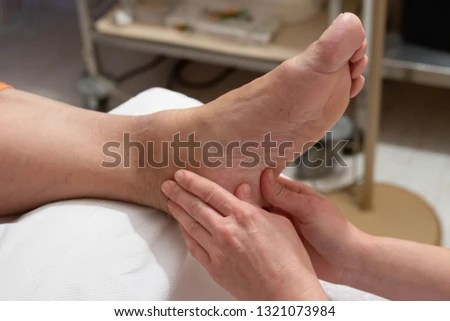 Free photos Foot massage / hands massaging a foot for relaxation