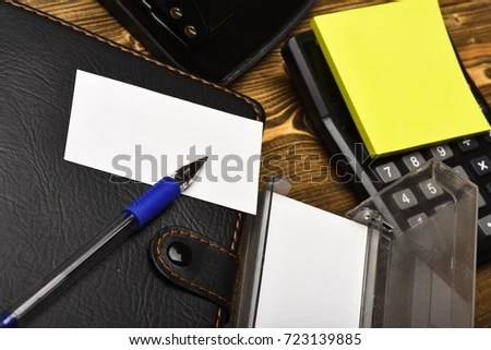 Calculator, hole punch, business card holder, note paper and pen