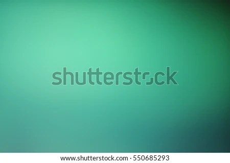 Blurred green soft light-colored background with a smooth gradient