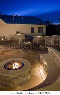 Backyard With Fire Pit, Outdoor Kitchen And Flagstone ...