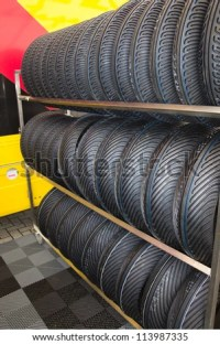 Rack With Motorcycle Tires Stock Photo 113987335 ...