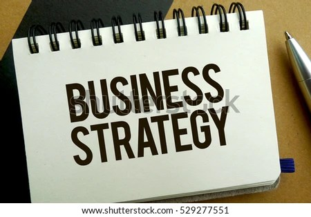 Business Strategy Memo Written On Notebook Stock Photo (Edit Now