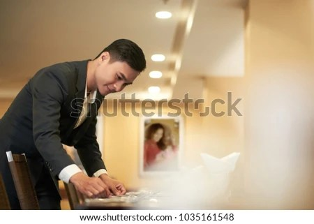 Catering Manager Checking Silverware On Restaurant Stock Photo (Edit