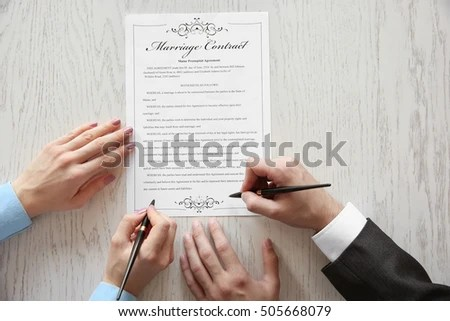 Couple Signing Marriage Contract Closeup Stock Photo (Edit Now