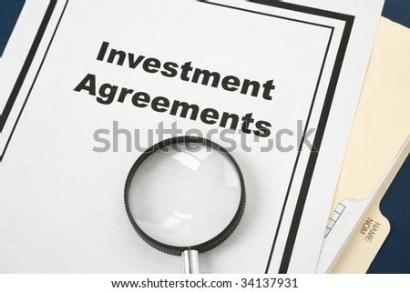 Investment Agreement Magnifying Glass Business Concept Stock Photo