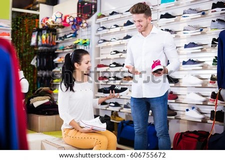 Male Shop Assistant Helping Customer Choose Stock Photo (Edit Now
