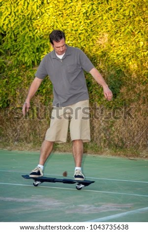 Man His Forties Rides Ripstik Inline Stock Photo (Edit Now