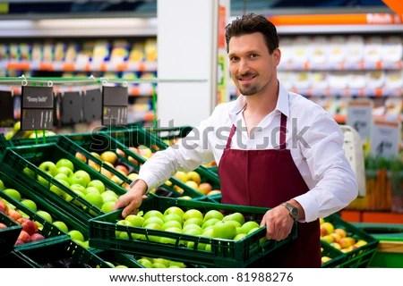 Man Supermarket Shop Assistant He Brings Stock Photo (Edit Now - shop assistan