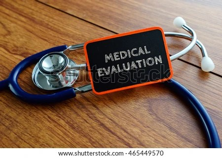 Medical Concept Word MEDICAL EVALUATION Stethoscope On Stock Photo
