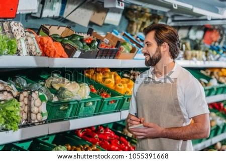 Portrait Smiling Shop Assistant Apron Notebook Stock Photo (Edit Now