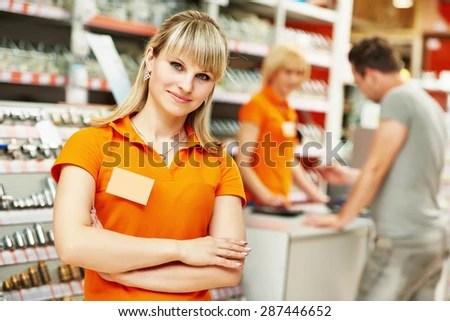 Positive Female Seller Shop Assistant Portrait Stock Photo (Edit Now