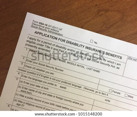 Social Security Disability Insurance Application Sitting Stock Photo