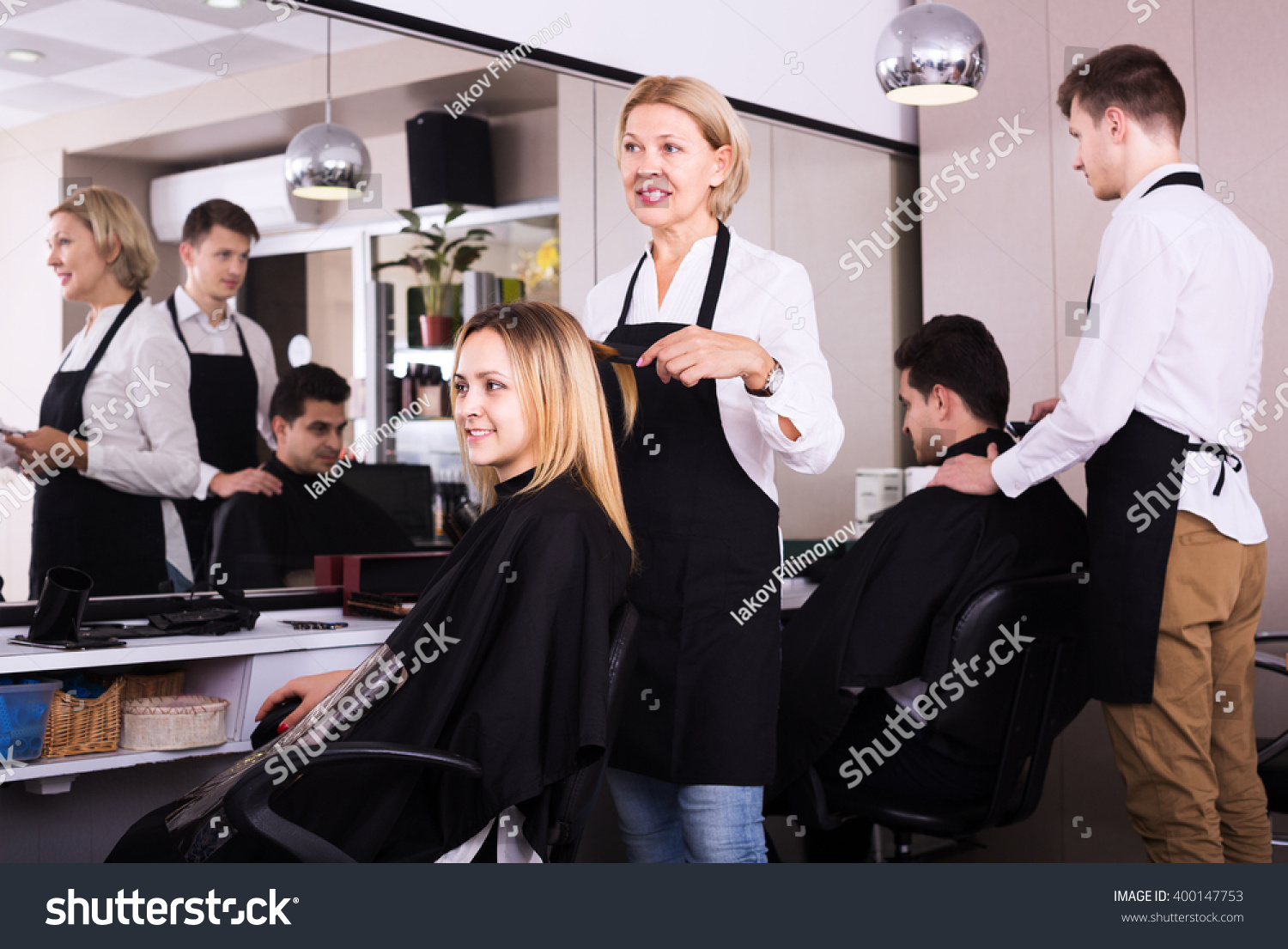 Salon Senior Senior Woman Cuts Hair Of Blonde Girl Stock Photo 400147753