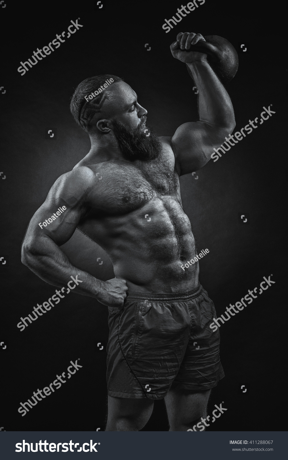 Kettlebell Bodybuilding Royalty Free Bodybuilder With A Beard Lifts A Heavy 411288067