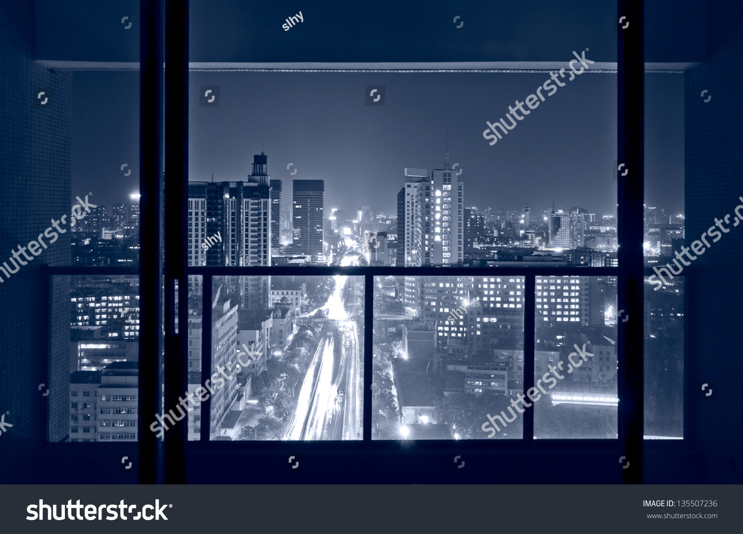 A bird s eye view of the city night view outside the window