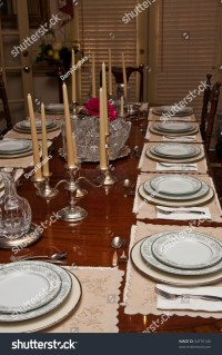 A Formal Dinner Table Set With China And Crystal Stock ...