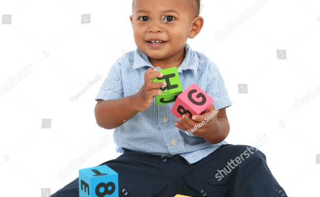 Adorable One Year Old African American Boy Playing Toy