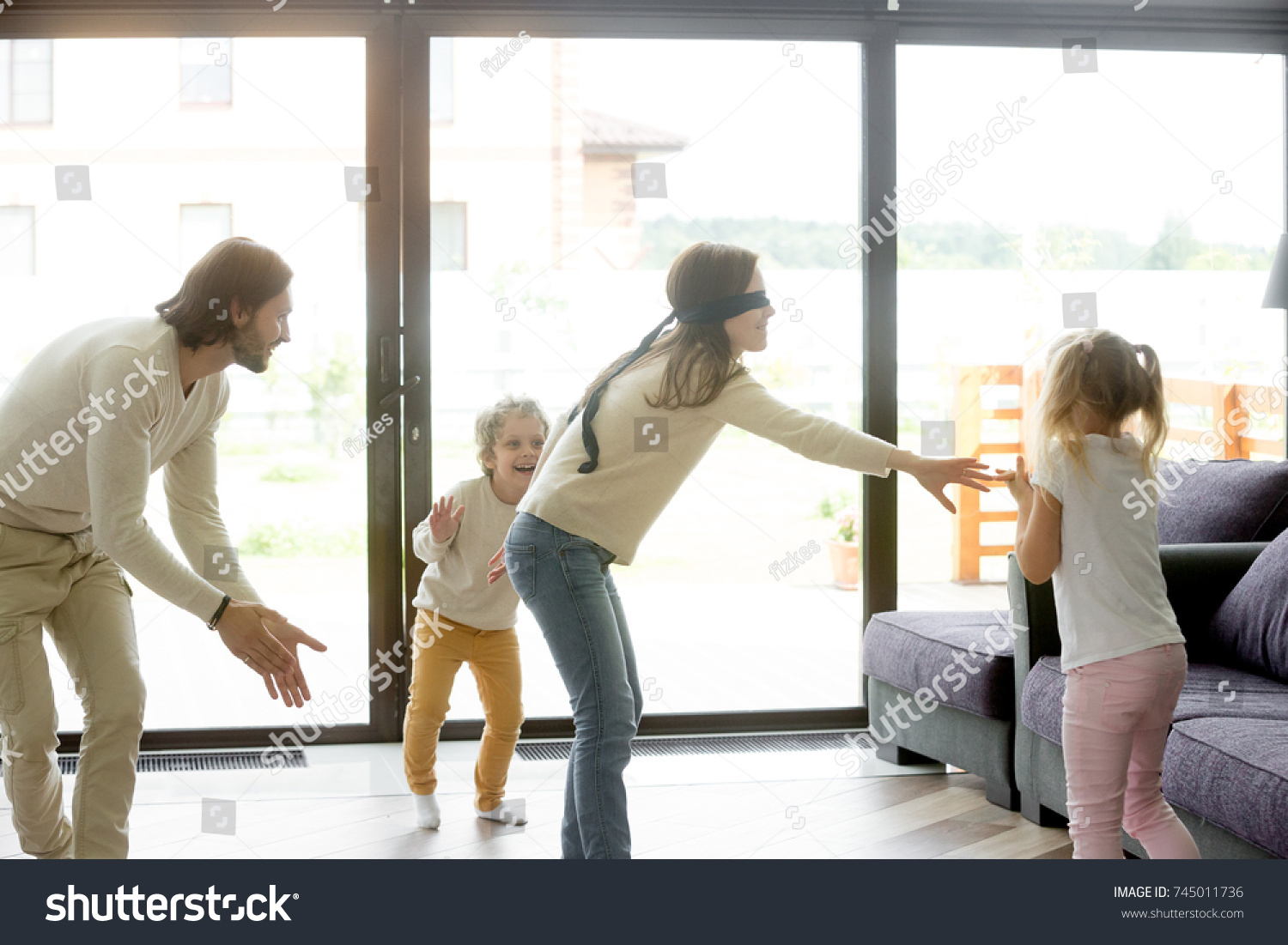 Hide And Seek Kids Blindfolded Mother Playing Hide Seek Game Stock Photo Edit Now