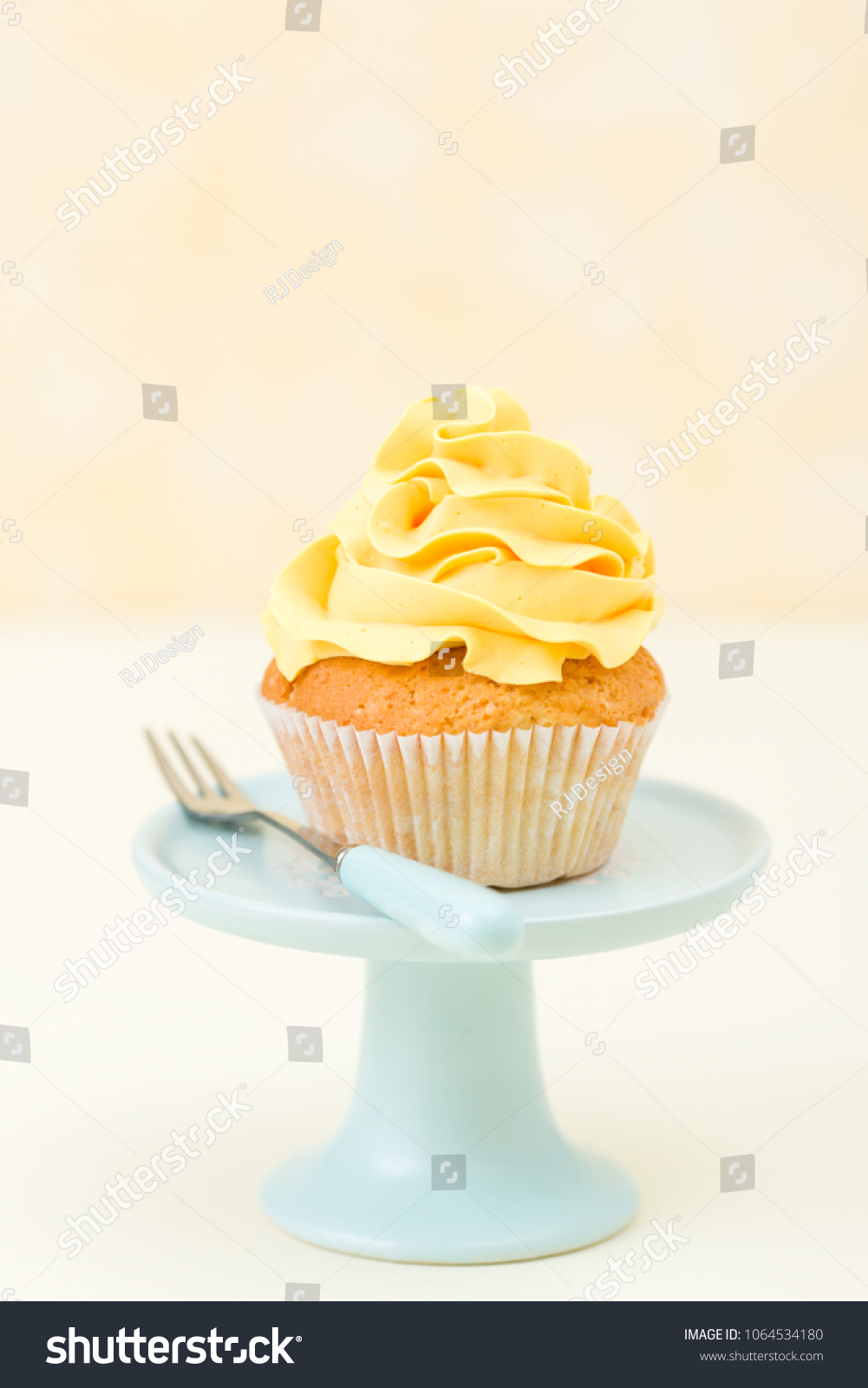Décoration De Cupcake Cupcake Yellow Cream Decoration On Blue Stock Photo Edit Now