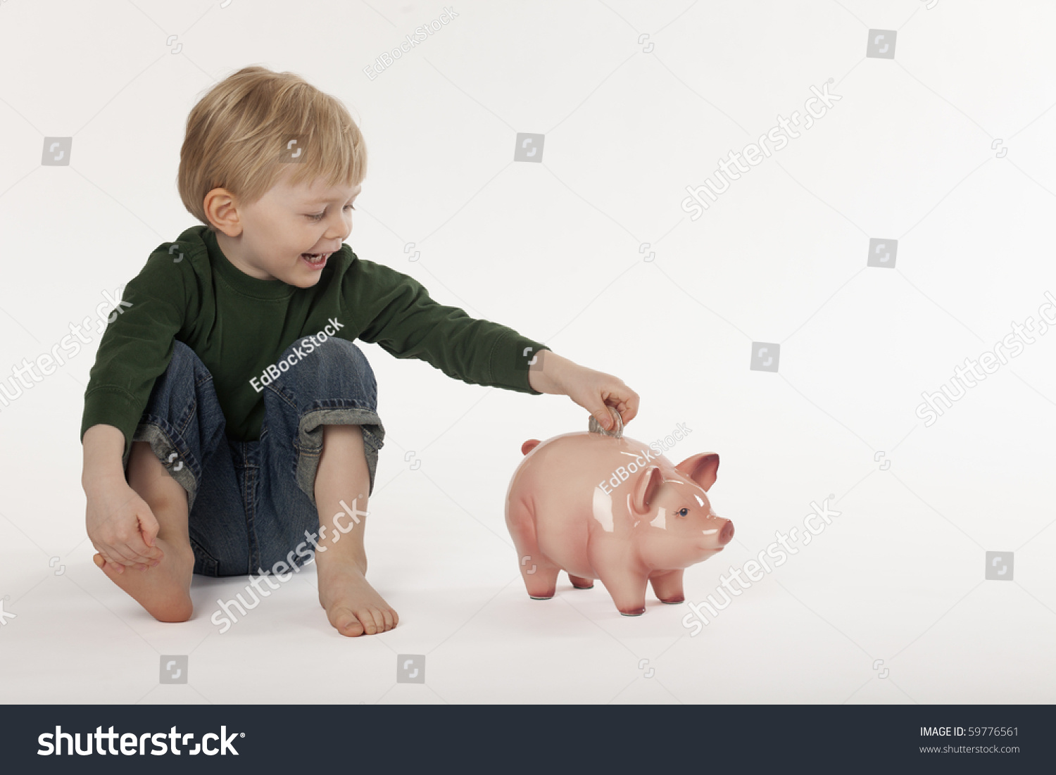 Piggy Banks For Little Boys Cute Little Boy Puts A Coin Into A Piggy Bank While