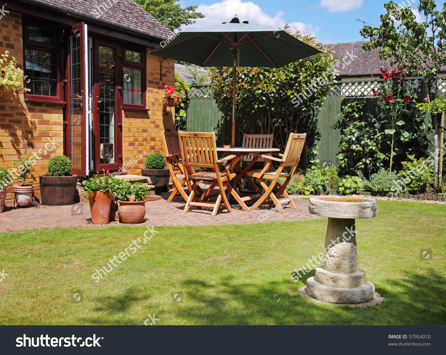 English Back Garden Patio Table Chairs Stock Photo