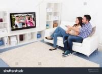 Happy Young Couple Livingroom Sitting On Stock Photo ...