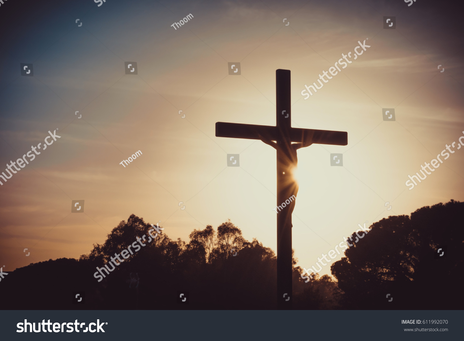 Jesus christ on the cross silhouette at sunset crucifixion on the calvary hill good