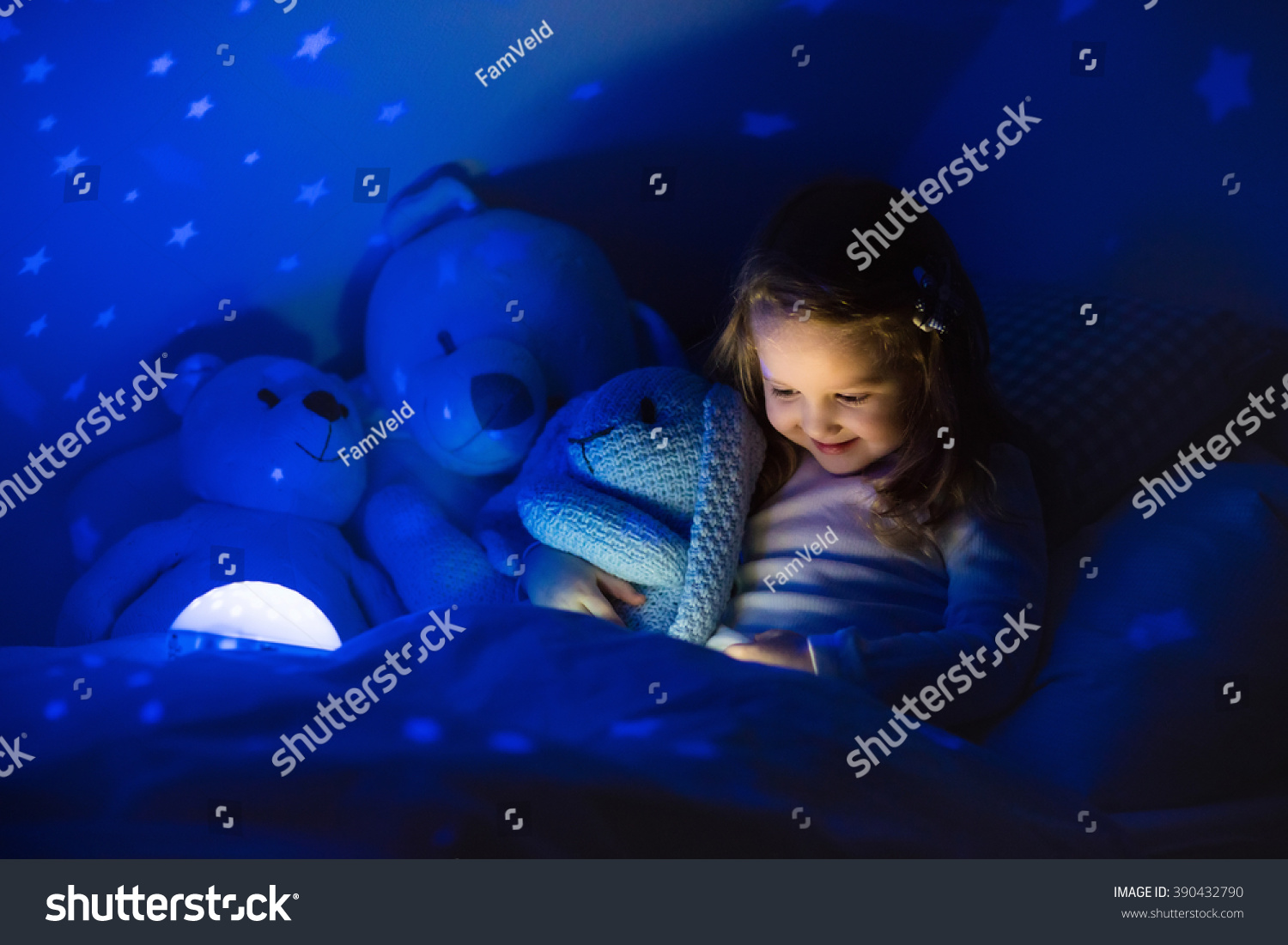 Glow Toys For Bedtime Little Girl Reading Book Bed Dark Stock Photo 390432790
