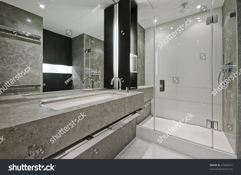 Luxury modern en suite bathroom with marble finish stock