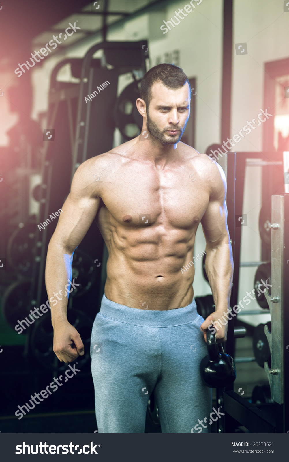 Kettlebell Bodybuilding Man Posing In Gym And Showing Abs Holding Kettlebell In Hand Ez