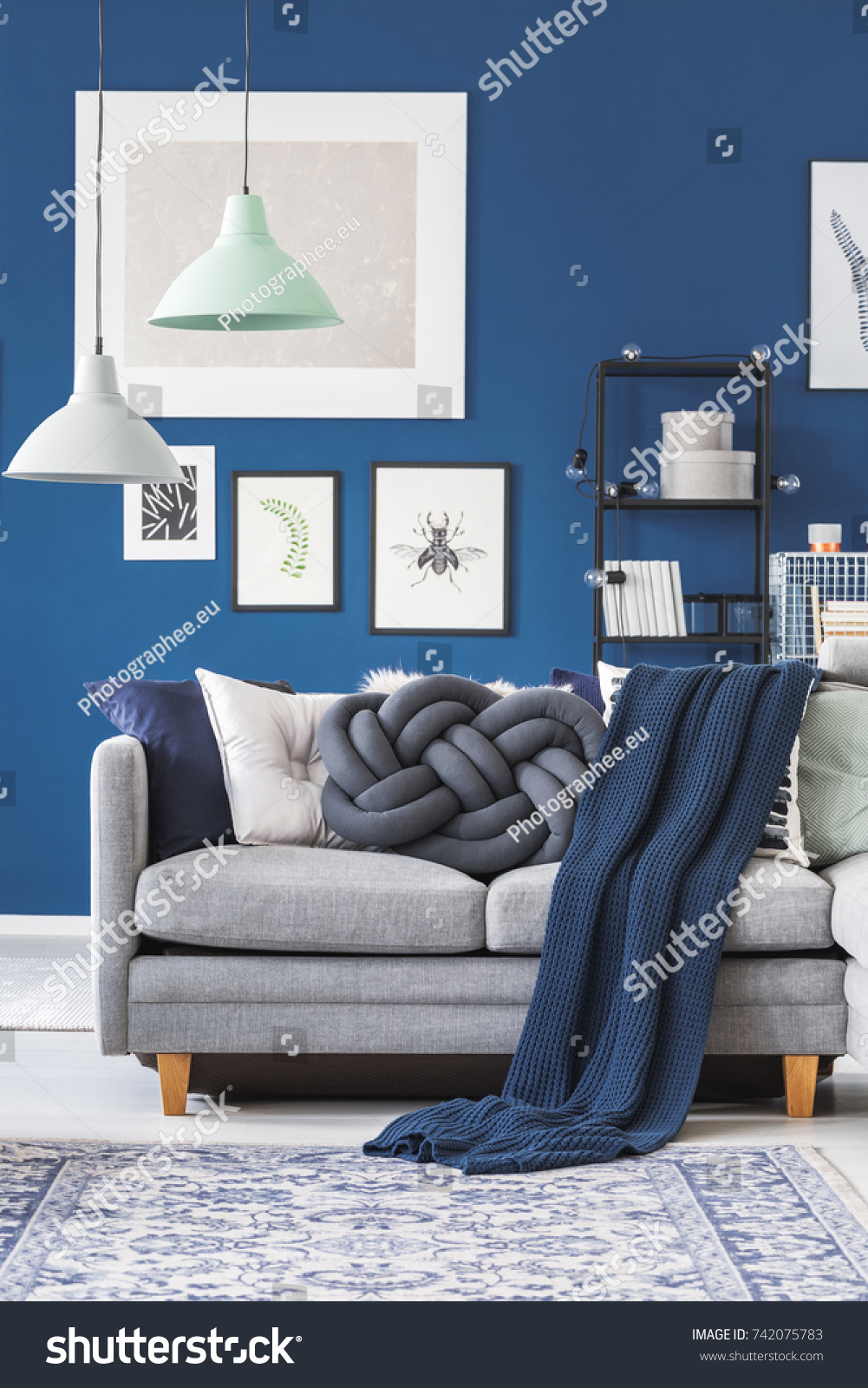 Grey White And Blue Living Room Mint White Lamp Above Grey Sofa Stock Photo Edit Now 742075783