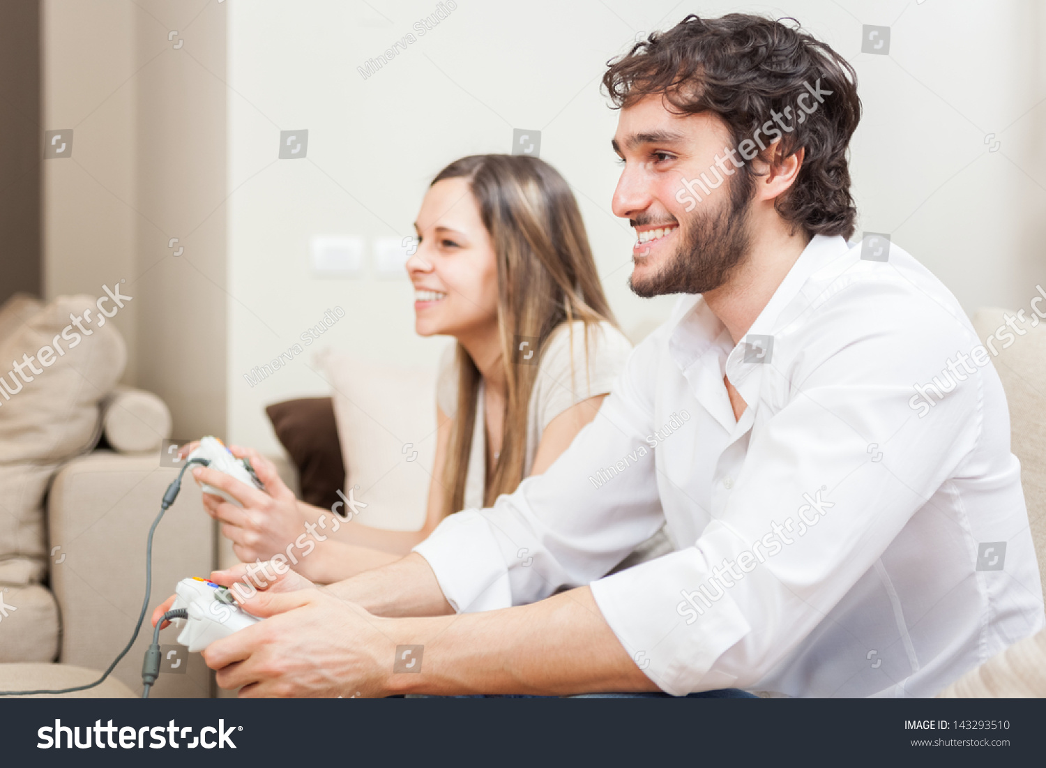 Young Couple Apartment Young Couple Playing Video Games In Their Apartment Stock