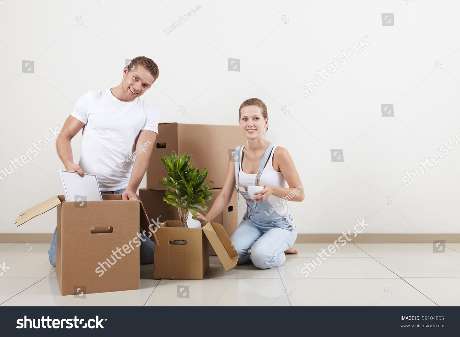 Young Couple Apartment Young Couple Unpacked In Our New Apartment Stock Photo