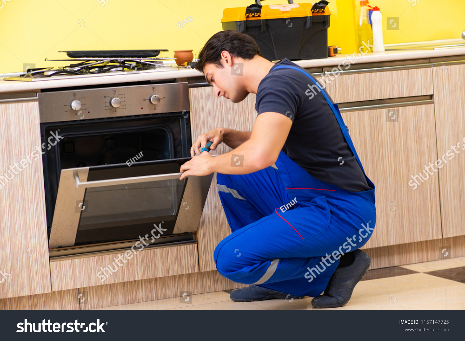 Service Contractor Young Service Contractor Assembling Kitchen Furniture Stock Photo