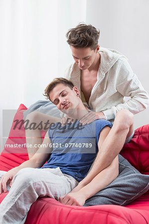 Homosexual couple massaging each other - Stock Photo - Masterfile