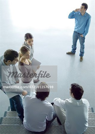 Informal business meeting, high angle view - Stock Photo
