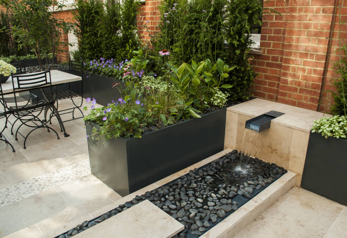 Imagenes con ideas para decorar tu jard n con fuentes de agua for Ideas para decorar tu jardin