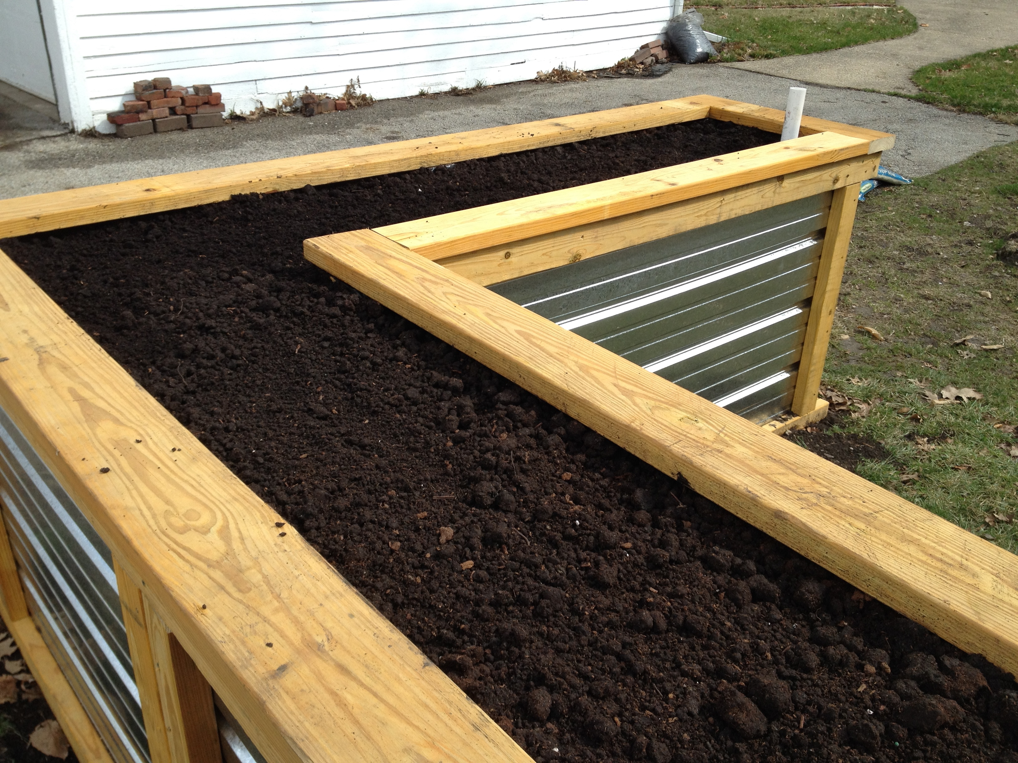 Make Self Watering Planters Building A Self Watering Raised Garden Bed Frugal Living