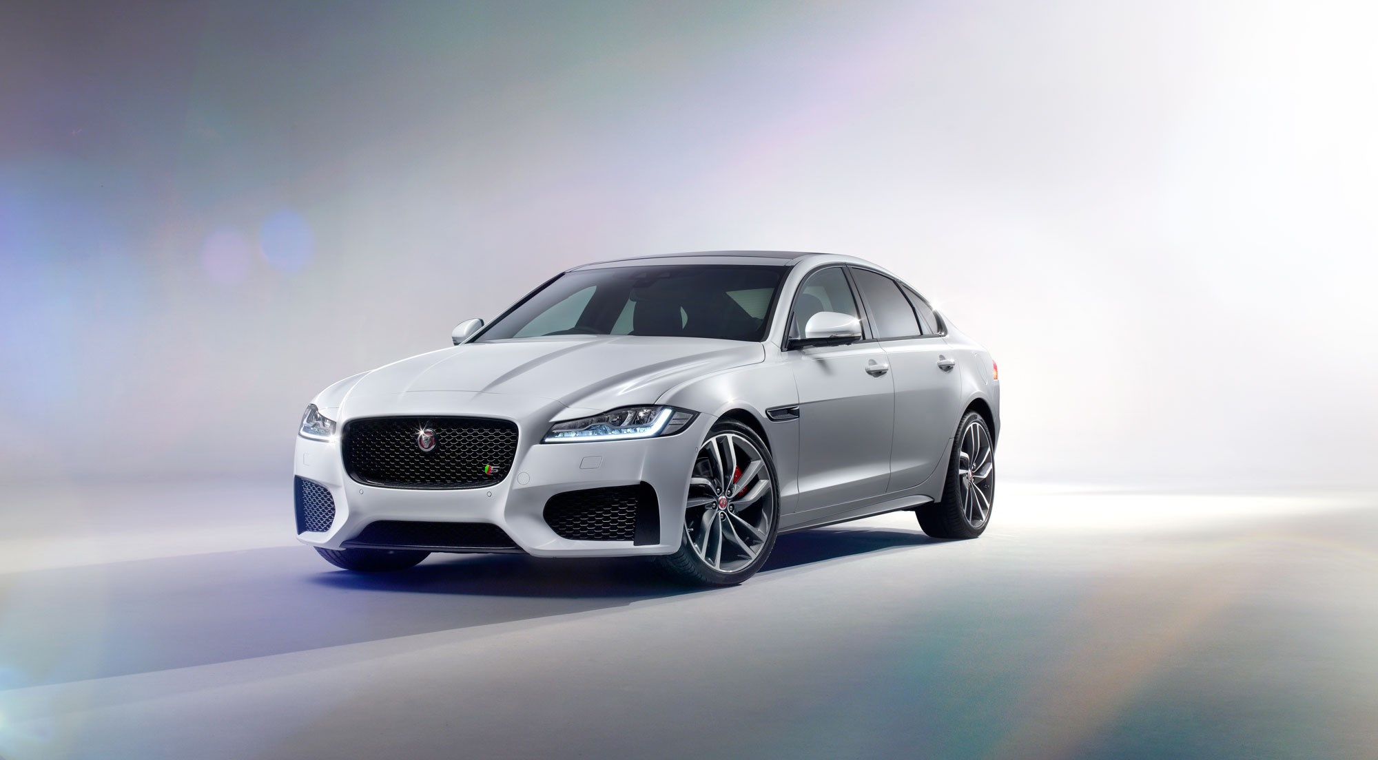 Jaguar Cars News New Jaguar Xf 2015 Revealed Honey I Inflated The Xe By