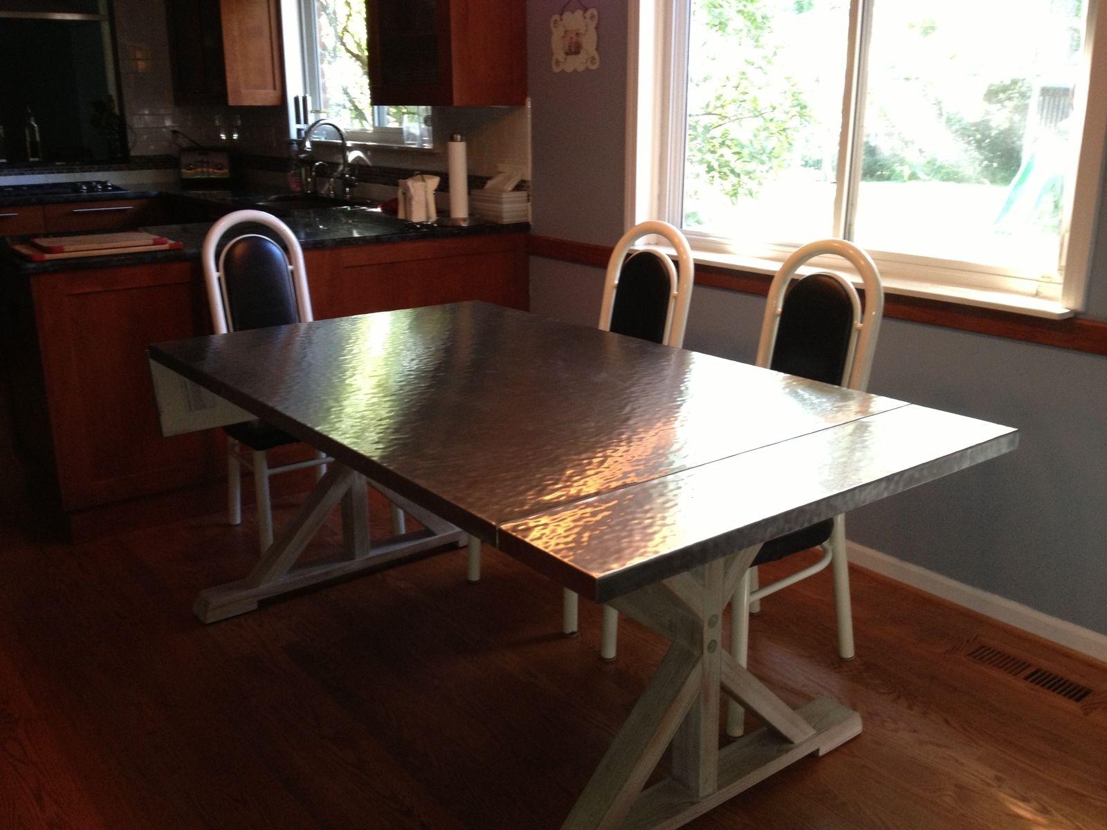 Custom made custom hammered stainless steel dining table