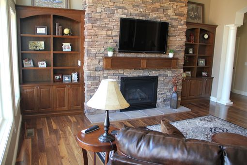 Hand Crafted Built In Bookcases And Fireplace Mantle By