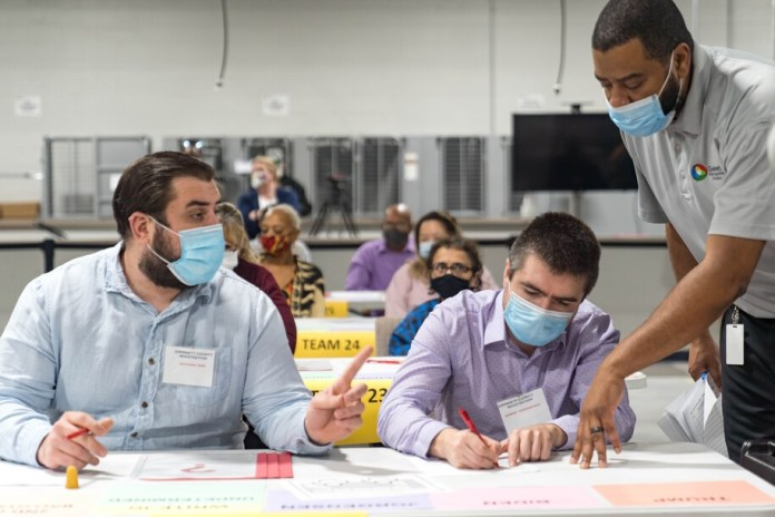 ATLANTA, GA - NOVEMBER 13: Gwinnett county workers begin their recount of the ballots on November 13, 2020 in Lawrenceville, Georgia. The difference in votes between US President Donald Trump and President-elect Joe Biden is about 14,000 as of right now. (Photo by Megan Varner/Getty Images)