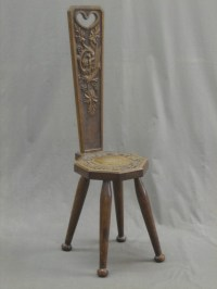 Lot No 99 A carved oak spinning chair