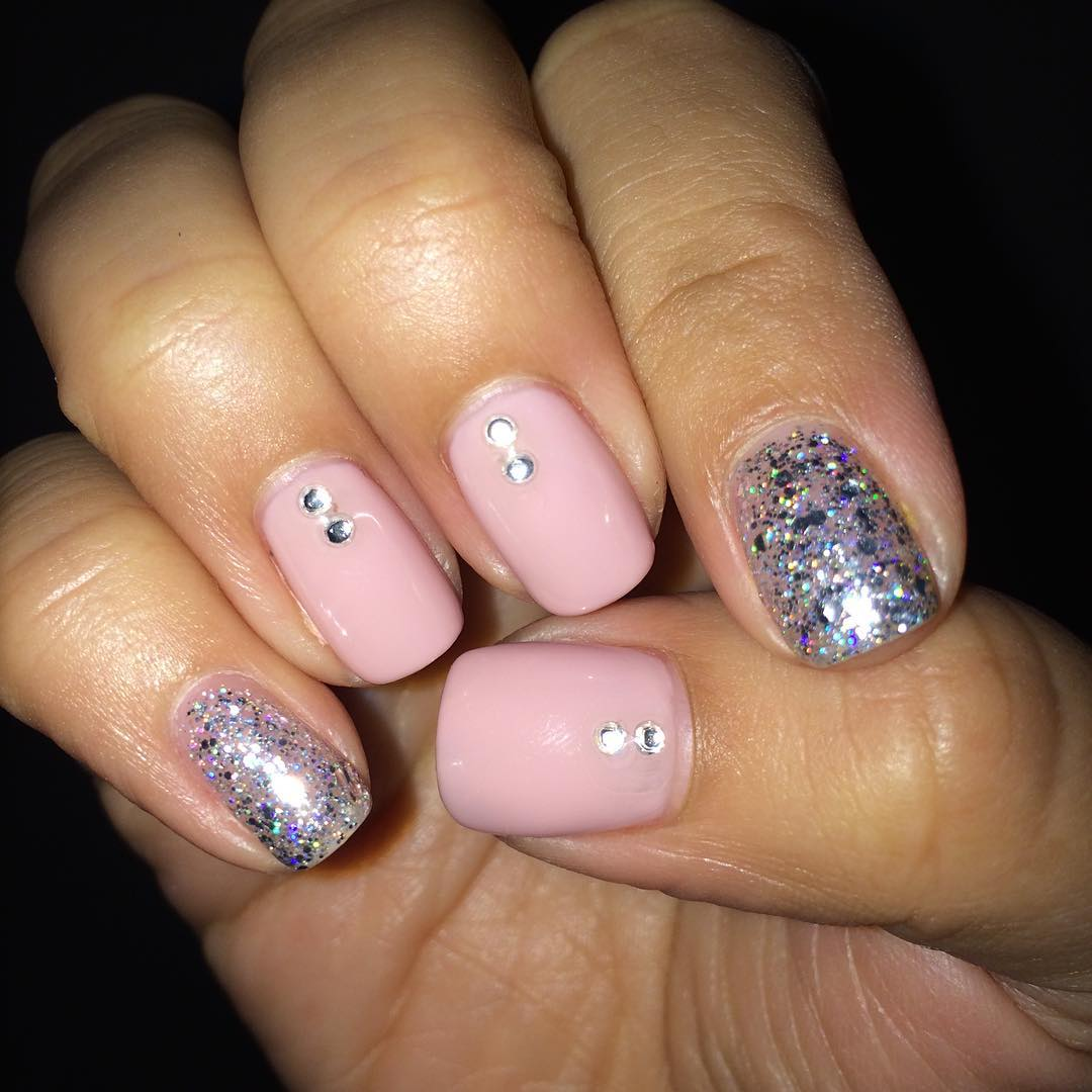 Glitter pink and silver nail design