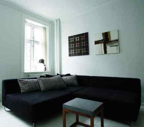 Departamento minimalista con muebles de cocina negros en for Muebles de departamento