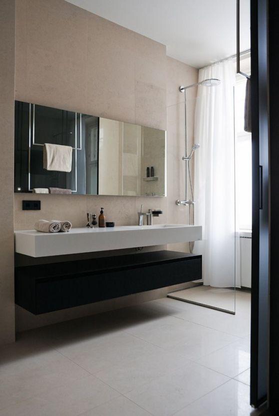 Baño Estilo Contemporaneo:Tonos oscuros en el diseño de un departamento contemporáneo