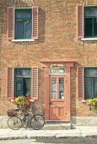 Old Downtown Building Doorway And Bike On Street ...