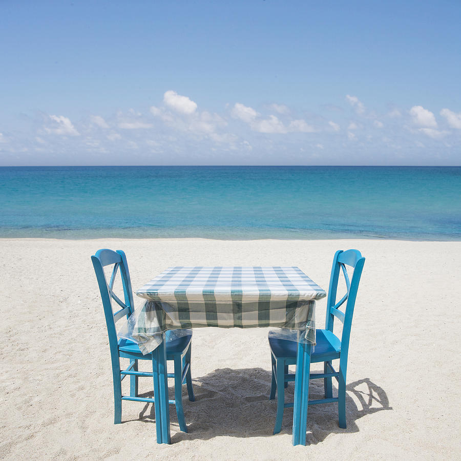 Restaurant Table And Chairs On Beach In Greece Photograph
