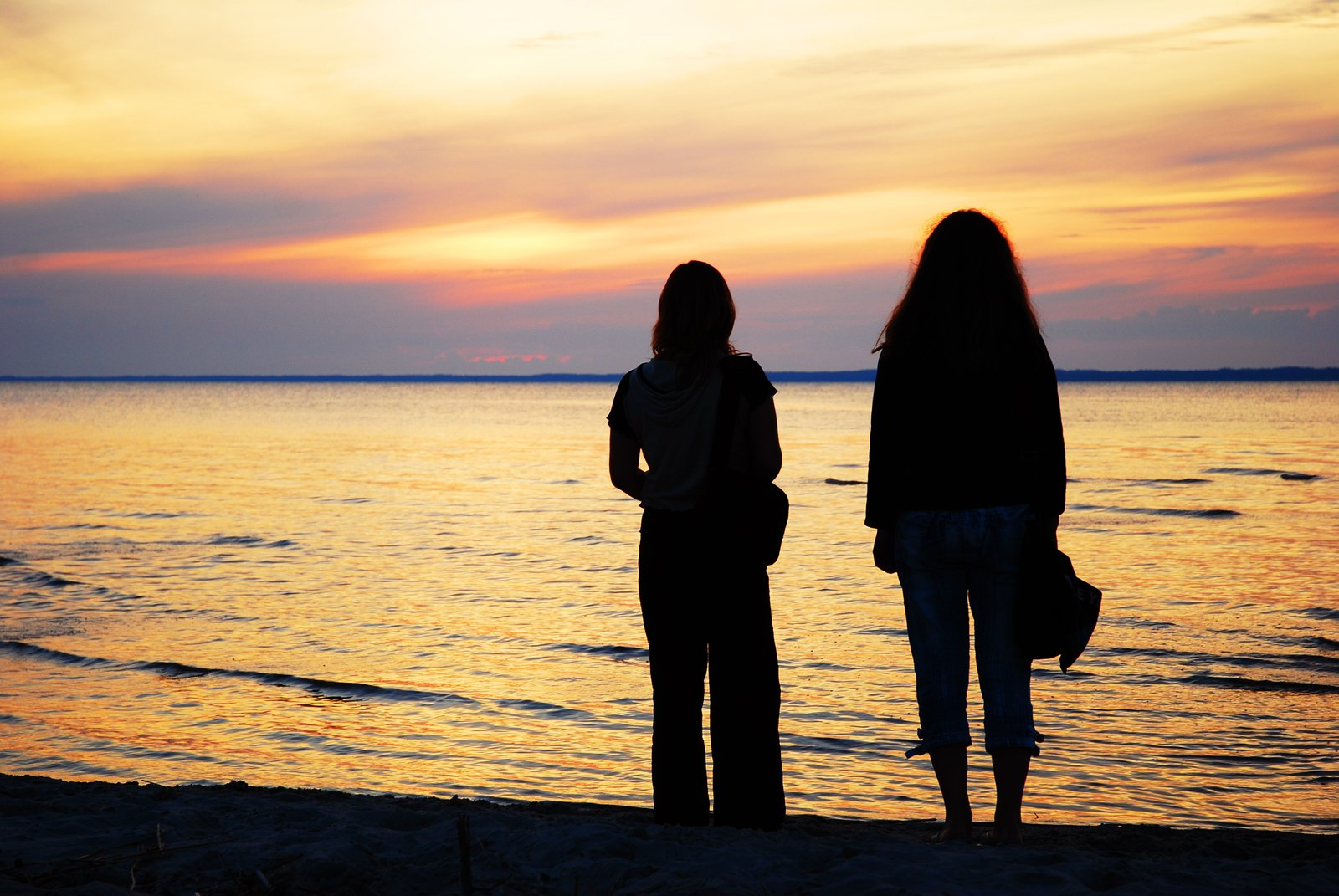 Sand Hair Brune Free Two Girls By The Sea At The Sunset Stock Photo