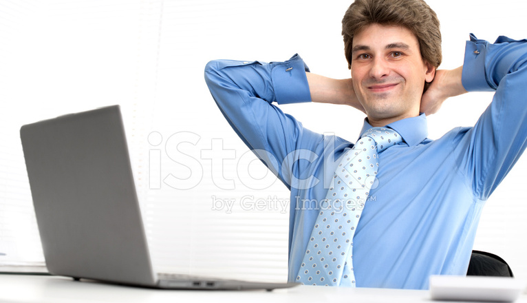 Smiling Handsome Businessman Relaxing IN A Office Stock Photos